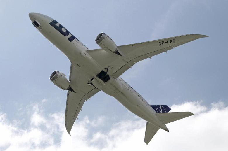 Boeing 787 Dreamliner belonging to Polish airline LOT flies after taking off from the Chopin International Airport in Warsaw in this June 1, 2013 file photo. REUTERS/Kacper Pempel