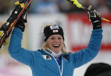 Austria's Marlies Schild after winning the women's giant slalom World Cup race in the Tyrolean ski resort of Lienz December 29, 2013. REUTERS/Leonhard Foeger