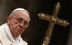Pope Francis looks on as he celebrates a mass in Saint Peter's Basilica at the Vatican February 2, 2014. REUTERS/Tony Gentile