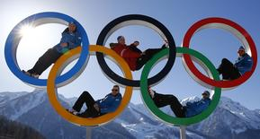 Austrian alpine skiers Georg Streitberger, Klaus Kroell, Max Franz, Joachim Puchner and Romed Baumann (L-R) pose for a photograph in the Olympic rings at the Olympic athletes mountain village in Rosa Khutor near Sochi, February 4, 2014. REUTERS/Kai Pfaffenbach