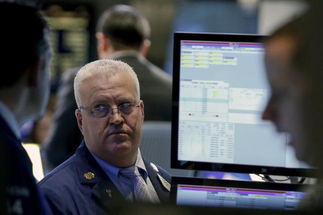 Traders work on the floor of the New York Stock Exchange February 3, 2014. REUTERS/Brendan McDermid