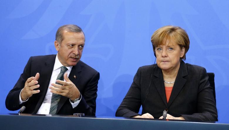 German Chancellor Angela Merkel and Turkey's Prime Minister Tayyip Erdogan address the media after talks in Berlin February 4, 2014. REUTERS/Tobias Schwarz
