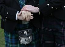 Larry Lamont and Jerry Slater (R) take part in a symbolic same-sex marriage outside the Scottish Parliament in Edinburgh, Scotland February 4, 2014. REUTERS/Russell Cheyne