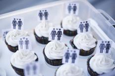 A box of cupcakes are seen topped with icons of same-sex couples at City Hall in San Francisco, June 29, 2013. REUTERS/Stephen Lam