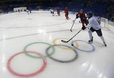 Finland's national women's ice hockey team take part in a training session at Shayba Arena in preparation for the 2014 Sochi Winter Olympics February 5, 2014. REUTERS/Grigory Dukor