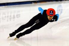 Jan 4, 2014; Kearns, UT, USA; J.R. Celski competes in the fourth heat in the 500m of the U.S. Olympic short track speedskating trials at Utah Olympic Oval. Mandatory Credit: Chris Nicoll-USA TODAY Sports