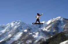 Snowboarder Roope Tonteri of Finland performs a jump during slopestyle snowboard training at the 2014 Sochi Winter Olympics in Rosa Khutor, Russia February 5, 2014. REUTERS/Dylan Martinez
