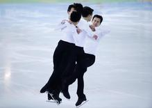 Patrick Chan of Canada skates during a figure skating training session in preparation for the 2014 Sochi Winter Olympics, February 2, 2014. REUTERS/Lucy Nicholson
