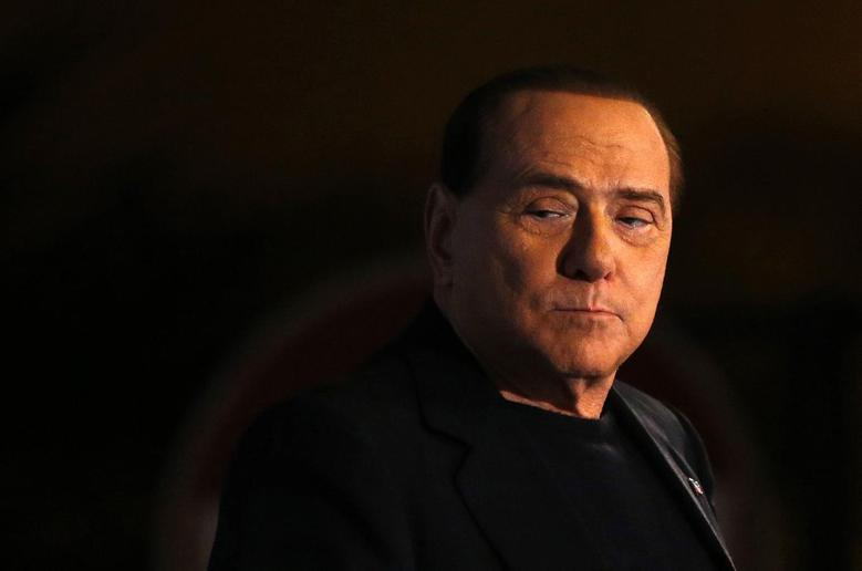 Former Prime Minister Silvio Berlusconi looks on during a speech from the stage in downtown Rome November 27, 2013. REUTERS/Alessandro Bianchi