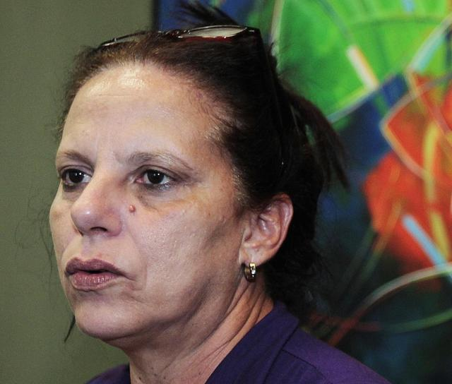 Cuban doctor, Ramona Rodriguez, 51, speaks in the office of the center-right Democratas Party where she presented her request for political asylum in Brasilia, February 5, 2014. REUTERS/Joedson Alves