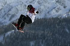 Canada's Sebastien Toutant performs a jump during the men's slopestyle snowboarding qualifying session at the 2014 Sochi Olympic Games in Rosa Khutor February 6, 2014. REUTERS/Dylan Martinez