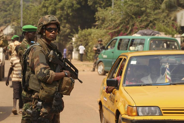 A French soldier carries his weapon as he takes a strategic position during a joint Chad MISCA French army patrol in Wouango district January 9, 2014. REUTERS/Emmanuel Braun