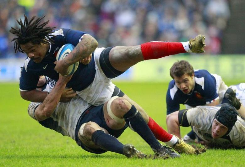 Scotland's Kelly Brown tackles France's Mathieu Bastareaud during their Six Nations rugby union match at Murrayfield stadium in Edinburgh, Scotland February 7, 2010. REUTERS/David Moir