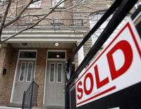 A sold sign is displayed in front of a home in Toronto December 15, 2009. REUTERS/Mike Cassese