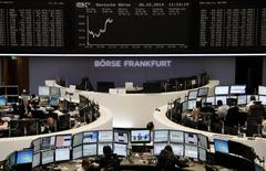 Traders are pictured at their desks in front of the DAX board at the Frankfurt stock exchange February 6, 2014. REUTERS/Remote/Stringer