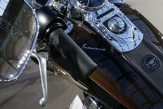 Pope Francis signature is seen on the tank of his 1,585 cc Harley Davidson Dyna Super Glide which is displayed as part of Bonham's Les Grandes Marques du Monde vintage and classic cars sale at the Grand Palais in Paris, February 5, 2014. REUTERS/Benoit Tessier