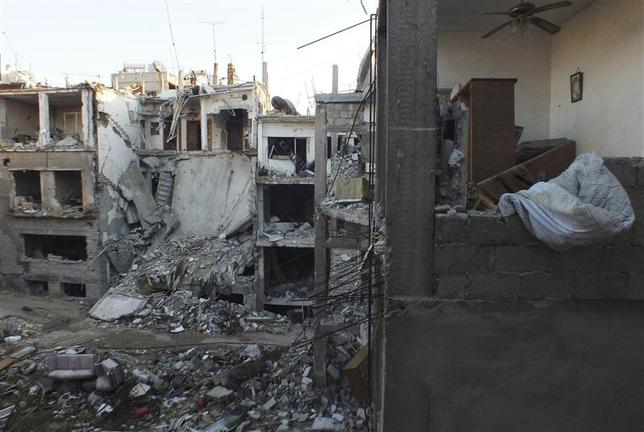 A general view shows damaged buildings in the besieged area of Homs February 5, 2014. REUTERS/Yazan Homsy