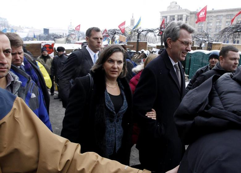 U.S. Assistant Secretary of State for European and Eurasian Affairs Victoria Nuland (C) and U.S. Ambassador Geoffrey Pyatt walk in the opposition camp at Independence Square in Kiev in this December 10, 2013, file photo. REUTERS/Vasily Fedosenko/Files