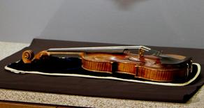 The 300-year-old Stradivarius violin that was taken from the Milwaukee Symphony Orchestra's concertmaster in an armed robbery is on display for the media after it was recently recovered, in Milwaukee, Wisconsin February 6, 2014. REUTERS/Darren Hauck