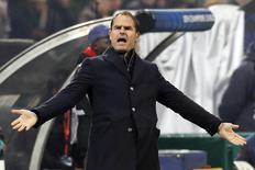 Ajax Amsterdam's coach Frank De Boer reacts during their Champions League group H soccer match against AC Milan at the San Siro stadium in Milan December 11, 2013. REUTERS/Stefano Rellandini