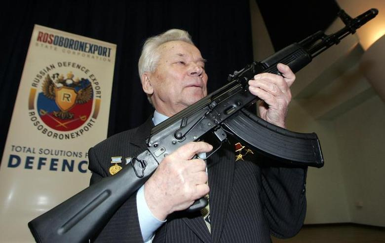 Mikhail Kalashnikov, chief designer of Izhmash Concern, a Russian firearms producer, poses with the latest model of his rifle during a news conference in Moscow April 15, 2006. REUTERS/Sergei Karpukhin/Files
