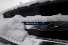 Snow surrounds the Chrysler logo displayed on a vehicle in the parking lot at Bill Snethkamp dealership in Detroit, Michigan January 2, 2014. REUTERS/Joshua Lott