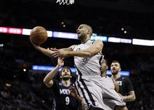 Jan 12, 2014; San Antonio, TX, USA; San Antonio Spurs guard Tony Parker (9) drives to the basket past Minnesota Timberwolves guard Ricky Rubio (9) during the first half at AT&T Center. Soobum Im-USA TODAY Sports