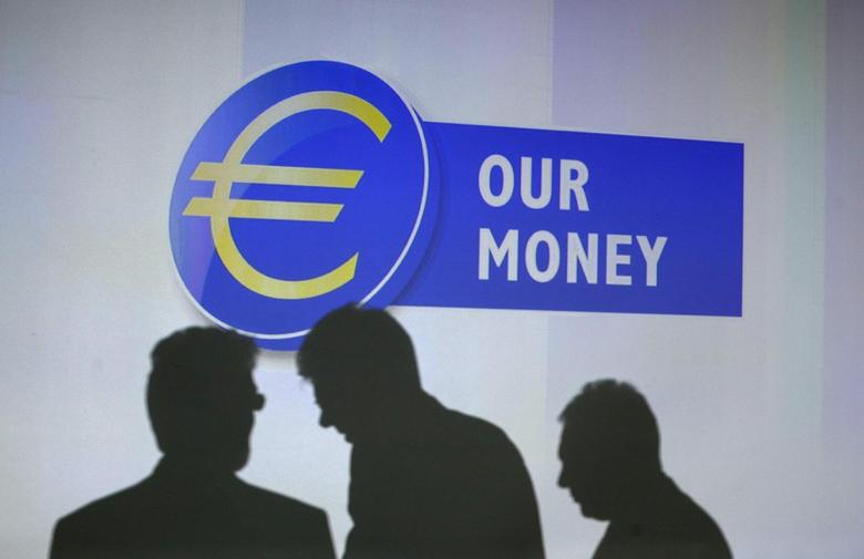 Guests of the presentation of the new 10 euro banknote throw a shadow on a video projection at the European Central Bank headquarters in Frankfurt, January 13, 2014. REUTERS/Ralph Orlowski