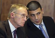 Aaron Hernandez (R) chats with his lawyer Charles Rankin as he appears for a pre-trial hearing at Bristol County Superior Court in Fall River, Massachusetts February 7, 2014. REUTERS/Jonathan Wiggs/Boston Globe/Pool