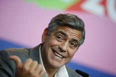 Cast member and director George Clooney reacts during a news conference to promote the movie 'The Monuments Men' at the 64th Berlinale International Film Festival in Berlin February 8, 2014. REUTERS/Thomas Peter