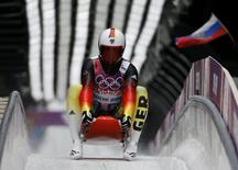 Germany's Felix Loch speeds down the track during the men's singles luge competition at the 2014 Sochi Winter Olympics, at the Sanki Sliding Center February 8, 2014. REUTERS/Fabrizio Bensch