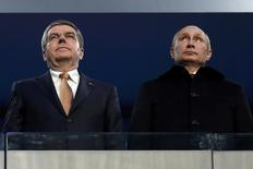 International Olympic Committee (IOC) President Thomas Bach of Germany and Russian President Vladimir Putin (R) stand together during the opening ceremony of the 2014 Sochi Winter Olympics, February 7, 2014. REUTERS/Phil Noble