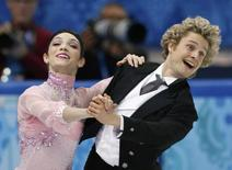 Meryl Davis (L) and Charlie White of the U.S. compete during the figure skating team ice dance short dance at the Sochi 2014 Winter Olympics, February 8, 2014. REUTERS/Alexander Demianchuk
