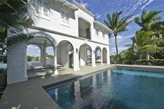 The pool house and pool of the waterfront mansion on Palm Island in Miami Beach, once owned by notorious gangster Al Capone, is shown in this handout photo provided by One Sotheby's International Realty February 8, 2014. REUTERS/One Sotheby's International Realty/Handout via Reuters
