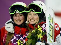 Canada's Chloe Dufour-Lapointe (L) and her sister Justine celebrate in the finish area during the women's freestyle skiing moguls final competition at the 2014 Sochi Winter Olympic Games in Rosa Khutor, February 8, 2014. REUTERS/Dylan Martinez