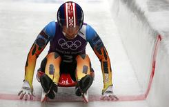 Kate Hansen of the U.S. speeds down the track during the women's luge training at the Sanki sliding center in Rosa Khutor, a venue for the Sochi 2014 Winter Olympics near Sochi, February 6, 2014. REUTERS/Murad Sezer