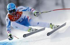 Austria's Matthias Mayer skis in the men's alpine skiing downhill race during the 2014 Sochi Winter Olympics at the Rosa Khutor Alpine Center February 9, 2014. REUTERS/Dominic Ebenbichler