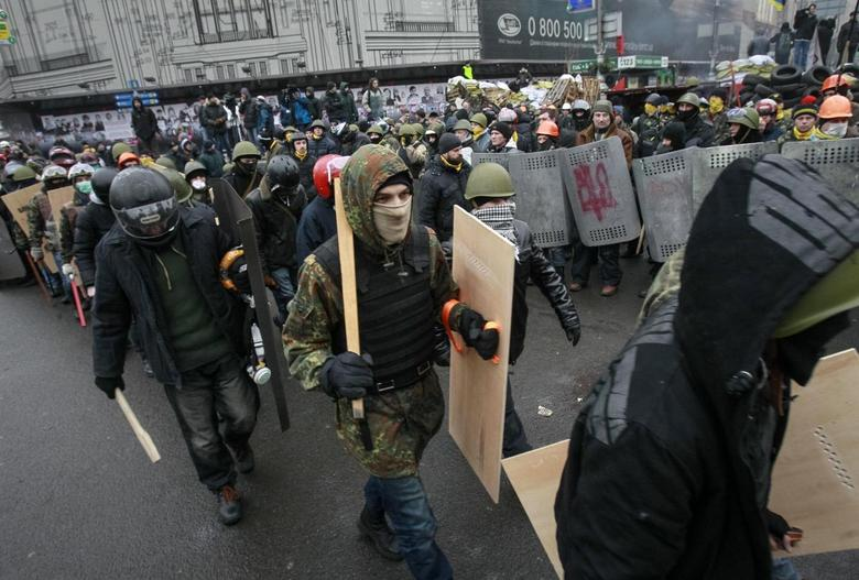 Anti-government protesters march on a street in central Kiev February 8, 2014. REUTERS/Gleb Garanich