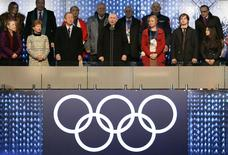 Russian President Vladimir Putin (C) declares the Olympic Games open during the opening ceremony of the 2014 Sochi Winter Olympics at the Fisht Olympic Stadium in Sochi February 7, 2014. REUTERS/Jung Yeon-Je