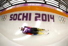 Germany's Andi Langenhan speeds down the track during a men luge training at the Sanki sliding center in Rosa Khutor, a venue for the 2014 Sochi Winter Olympics near Sochi, February 7, 2014. REUTERS/Arnd Wiegmann