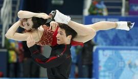 Tessa Virtue and Scott Moir of Canada's figure skating team compete during the Team Ice Dance Free Dance at the Sochi 2014 Winter Olympics, February 9, 2014. REUTERS/Lucy Nicholson