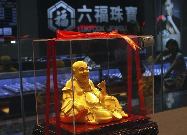 A gold Buddha statuette is seen inside a Luk Fook Jewellery shop in Yichang, Hubei province, May 20, 2012. REUTERS/China Daily/Files