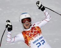 Julia Mancuso of the U.S. celebrates in the finish area after competing during the downhill run of the women's alpine skiing super combined event during the 2014 Sochi Winter Olympics February 10, 2014. REUTERS/Leonhard Foeger
