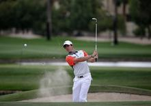 Rory McIlroy of Northern Ireland hits the ball out of the bunker on the 13th hole during the final round of the 2014 Omega Dubai Desert Classic in Dubai February 2, 2014. REUTERS/Ahmed Jadallah
