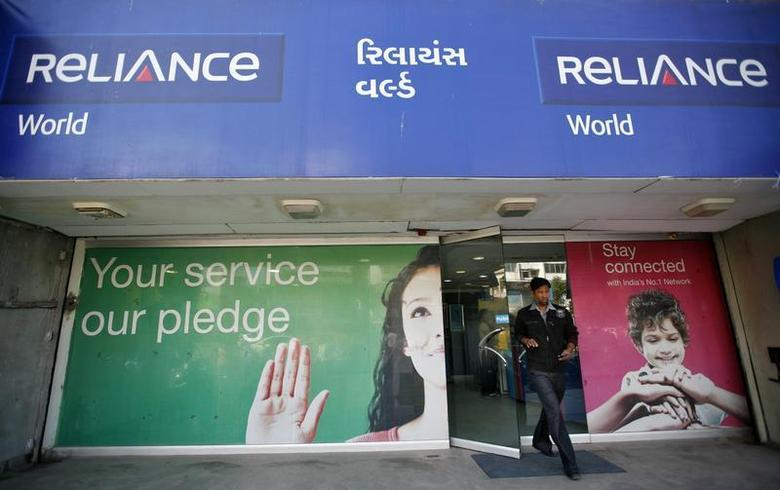 A customer leaves a Reliance communication store in the western Indian city of Ahmedabad January 23, 2013. REUTERS/Amit Dave