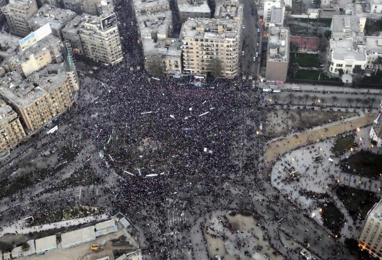 An aerial view made from an Egyptian army helicopter shows a general view of supporters of Egypt's army and police gathering at Tahrir Square in Cairo, on the third anniversary of Egypt's uprising, January 25, 2014 file photo. REUTERS/Stringer