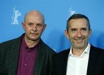 """Director Pascal Chaumeil (R) and writer Nick Hornby pose during a photocall to promote the movie """"A Long Way Down"""" at the 64th Berlinale International Film Festival in Berlin February 10, 2014. REUTERS/Thomas Peter"""