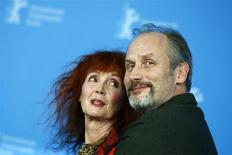 """Cast members Sabine Azema (L) and Hippolyte Girardot pose during a photocall to promote the movie """"Aimer, Boire Et Chanter"""" (Life of Riley) at the 64th Berlinale International Film Festival in Berlin February 10, 2014. REUTERS/Thomas Peter"""