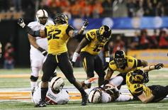 Jan 3, 2014; Arlington, TX, USA; Missouri Tigers defensive lineman Michael Sam (52) reacts after a play during the second half against the Oklahoma State Cowboys in the 2014 Cotton Bowl at AT&T Stadium. Mandatory Credit: Kevin Jairaj-USA TODAY Sports