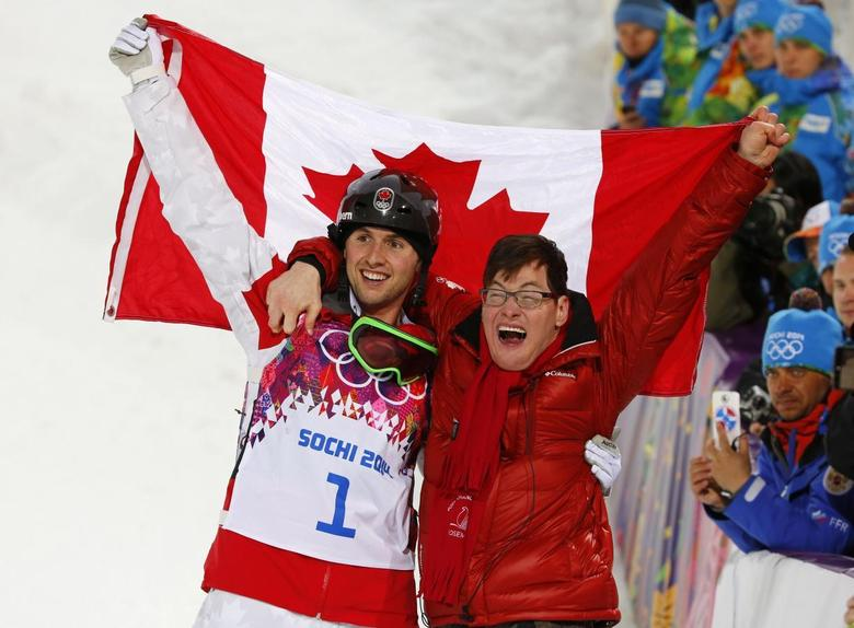 Winner Canada's Alex Bilodeau and his brother Frederic celebrate following the freestyle skiing moguls competition at the 2014 Sochi Winter Olympic Games in Rosa Khutor February 10, 2014. REUTERS/Mike Blake